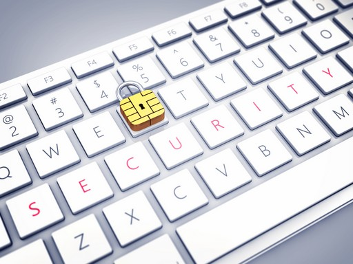 Credit card security chip as padlock on a computer keyboard